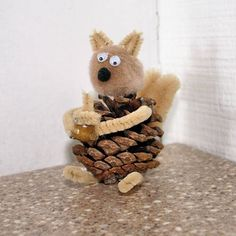 nature craft for kids - this would be even better if it had a walnut for a head and a real acorn in its hands, and sticks for arms and legs.