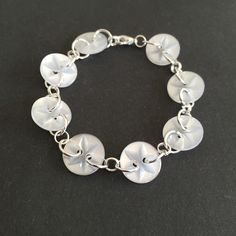 A personal favourite from my Etsy shop https://www.etsy.com/listing/231413717/white-retro-button-linked-bracelet