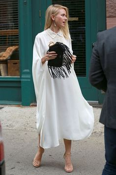 Naomi Watts in a flowy white dress, fringe clutch & nude sandals