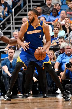 JaVale McGee of the Golden State Warriors handles the ball against the Orlando Magic on January 22 2017 at Amway Center in Orlando Florida NOTE TO...