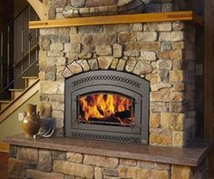 Cleveland Fireplaces including wood fireplaces, wood fireplace inserts, gas fireplaces and gas fireplace inserts. Shop efficient fireplaces in Cleveland. Pellet Fireplace, Fireplace Hearth, Wood House Design, Wood Interior Design, Grey Wood Tile, Wood Tile Floors, Wood Fireplace Inserts, Light Wood Texture, Wood Cafe