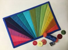 It's a burst of rainbow color! Follow this tutorial (plus get the free pattern) to quilt a rainbow paper-pieced mug rug.