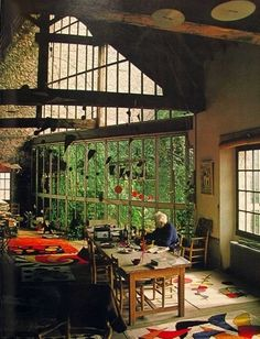 Alexander Calder's dining room- that greenhouse style wall blurs the lines between outside and inside.