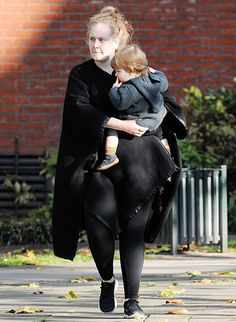 Adele steps out with her growing son Angelo.