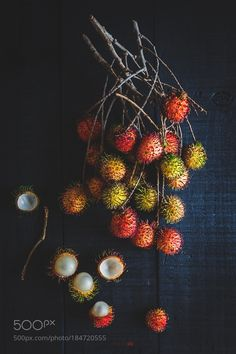 Red Rambutans on the dark background... by ThaiThu