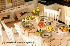 Emilian kotona Havumetsäntiellä Easter table cloth and bunny pillows on the bench