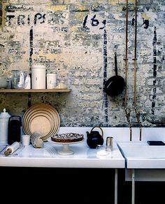 Exposed brick with pipes running down to sink, exposed brick wall that has been white washed <3 it!