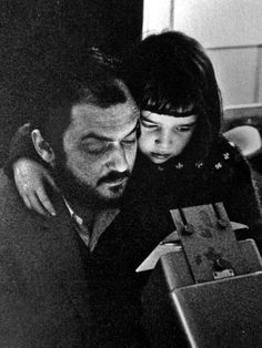Photo of Stanley Kubrick and his daughter Vivian at home while he is editing a film.