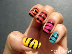 Multicolor Mummy Nails. From Nailside Blog. http://nailside.blogspot.com/2011/07/mummy-skittle.html