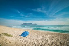 They were the first days of spring in Cape Town. There was a light fog above the ocean and the beach, but to catch my attention it was this blue umbrella like the sky and the sea.