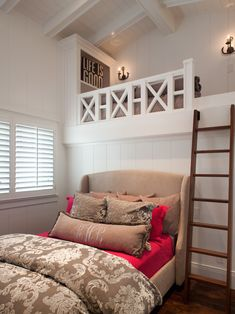 Bedroom with loft. What a great use of space for a room with a vaulted ceiling. A walk in closet could be under that loft and you haven't lost any space.  I would love a space like this