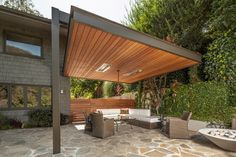 modern patio covers Patio Contemporary with awning climbing plants covered