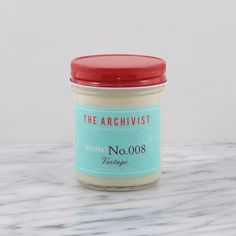 """JASON'S JAM...JAR This special candle, by the Archivist, is Jason's (Paramour Bungalow's Co-Owner) very favorite scent (VINTAGE)! He's so addicted. 7OZ. soy candle w/cotton wick. Glass jam jar w/red screw cap. Reusable. 3.63"""" X 2.75"""". Burn Time: 47 hours. Hand poured in small batches. Numbered & signed."""