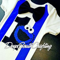 Cookie monster sesame Street theme baby boy onesie bodysuit toddler shirt bow tie suspenders number 1,2,or 3. Sizes up to 4-5T. First birthday smash cake party theme. Fun fashion for babies. Created by: DeepSouthCrafting