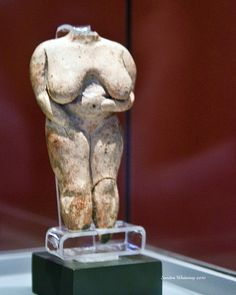 The so called 'Venus of Malta' from Hagar Qim. Made from hard-fired buff clay with a grey core , its head and feet are broken off. The modelling of the figurine is extremely good, especially on the back. It was found in the first room of the temple, next to the spiral slab, in 1839. https://www.flickr.com/photos/21108304@N02/4858540208/