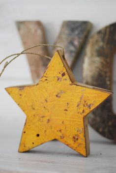Yellow star Christmas ornaments. It doesn't have to be only green and red.  Christmas tree colors this year: red, gray (silver) and yellow.