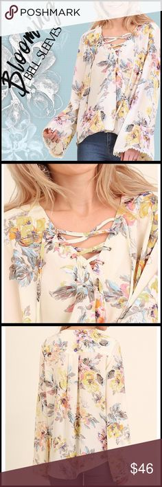 Blooming Bell Sleeves Top Blooming Bell Sleeves Top; faux crossover front; Hi-lo hemline, shorter in front, longer in back (see measurements); polyester Georgette fabric- not sheer; flared sleeve with lace trim; see measurement in chart to assure proper fit. Boutique Tops