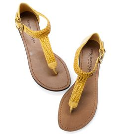 Project Runway winner Christian Siriano designed these T-straps in the season's new neutral: go-with-everything yellow. ($24.99; payless.com).