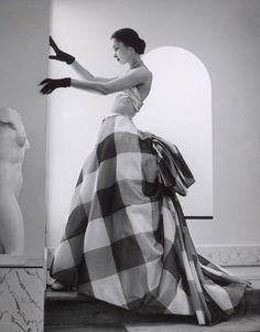 "Model with sculpture Photograph by André Ostier-Heil. Model is wearing a silk dress by Pierre Balmain for the summer 1952 collection. Known for sophistication and elegance, Balmain described the art of dressmaking as ""the architecture of movement. Moda Vintage, Moda Retro, Vintage Mode, Vintage Dior, French Vintage, Pierre Balmain, Vintage Beauty, Vintage Glamour, Vestidos Vintage"
