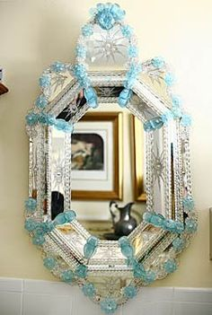 I love vintage Murano glass mirrors, in particular the styles that feature hand blown glass flowers. This style is a little more detailed than most and dates to the 19th century.