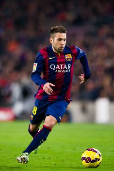 Jordi Alba of FC Barcelona runs with the ball during the La Liga match between FC Barcelona and Club Atletico de Madrid at Camp Nou on January 11, 2015 in Barcelona, Catalonia.