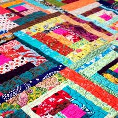 Scrappy, Log Cabin patchwork quilt made in bright, modern colors