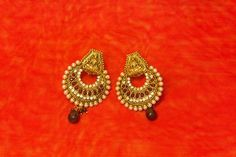 Stunning beautiful temple earrings with Red pearls