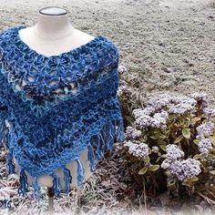 Winter poncho #blueyarn #wool  #crochet #crochetponcho #winterflower #MianVirkkuut #virkattuponcho #tilaustyö #madetoorder #talvikukkia