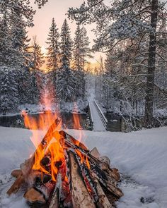 Winter fire combines the coldest snow with the warmest fire...like two lovers of opposite personalities that attract each other and burn all night long...  #winter #fire #opposites #attract #nature #snow #naturephotography #forest #view #fireplace #peace