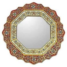 """Artisan-crafted wall mirror with a reverse-painted glass frame. Made in Peru.Product: Mirror  Construction: Plywood and mirrored glass    Color: MultiFeatures:   Rich golden borders     Handcrafted   Dimensions:  17.3"""" Diameter"""