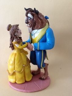 the bella and the beast , cake topper Belle Cake, Fondant Figures, Plant Art, Beauty And The Beast, Cake Toppers, Biscuits, Polymer Clay, Bolo Fake, Modeling