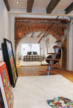 dahlarna - nice loft in Sweden.-- like the brick arch, interesting with the modern staircase... not sure I'd do it, but it's neat