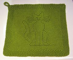 Charted pattern for a cat themed dishcloth. This is a general chart, no specific yarn/needle requirements are given.