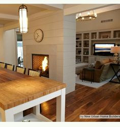 I'd prefer to separate the living space from the kitchen with a fireplace rather than with a bar/counter.