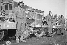 These drivers of the 666th Quartermaster Truck Company, 82nd Airborne Division, who chalked up 20,000 miles each without an accident, since arriving in the European Theater of Operations.   National Archives Identifier: 535533