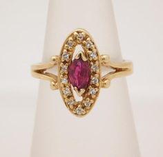 VINTAGE LADIES MARQUISE CUT RUBY & ROUND CUT DIAMOND CLUSTER RING 10K…