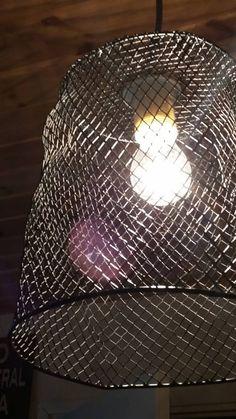 Old metallic waste of basket. DIY light.