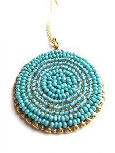 Turquoise bead embroidered pendant