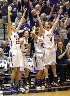Ashland University's Sara Loomis (23), Maddie Dackin (20), Julie Worley (42) and Renee Stimpert (4) cheer on the bench after a three pointer by Kelsey Peare in the third quarter during college women's basketball action Tuesday, March 21, 2017 in their NCAA Division II Elite Eight National quarterfinal game at Alumni Hall on the campus of Ohio Dominican University. T-G Photo/Tom E. Puskar