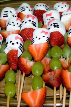 Food for a Hello Kitty Party.  Hello Kitty marshmellow heads faced in with gel on skewers with strawberries and grapes.  A fun way to do something vaguely healthy.