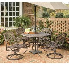 Home Styles 5555-305 Biscayne 5-Piece Outdoor Dining Set, Rust Bronze Finish, 42-Inch by Home Styles. $1158.83. Comes in a rust bronze finish. Biscayne 5-piece outdoor dining set. Table measures 42-inch diameter by 29-inch height. Set includes one round table and four swivel arm chairs. Made of cast aluminum. This biscayne 5-piece outdoor dining set is a dominating set that will draw every eye to the intricate detailed metal work. Constructed of solid, cast aluminum...