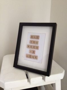 All You Need Is Love framed artwork for the home made from scrabble tiles on Etsy, $24.15