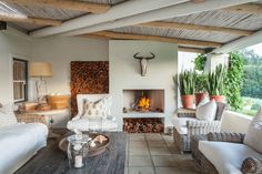 You and nine other guests will have plenty of time to enjoy the outdoor fireplace that overlooks the gardens and Keurbooms River. Outdoor Spaces, Outdoor Living, Outdoor Kitchens, Built In Braai, Outdoor Cabana, African House, Renting A House, Sweet Home, New Homes