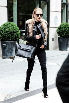 """runwayandbeauty: """" Rosie Huntington-Whiteley leaves her hotel in Soho, New York on April 29, 2016. She wore a leather jacket with a fur vest, jeans, and black heels. """""""