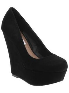 Steve Madden wedges I love these...and if I don't have them by my 21st, that will give me an excuse to buy them haha but I think I want glittery shoes..