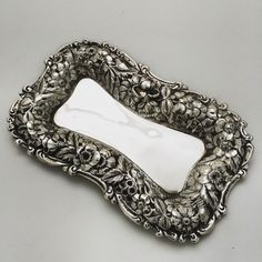 Antique sterling dresser tray with fabulous represent border by Simons and Brothers!
