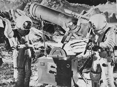 Dr. Cargraves (Warner Anderson) takes a souvenir photo of Joe Sweeny (Dick Wesson). Note how Sweeny's hand is upraised to appear to be supporting the Earth in Destination Moon, 1950.