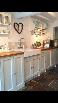 This is actually my dream kitchen! Wooden surfaces, duck egg cupboards & slate floor...perfect!