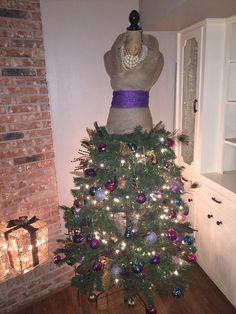Peacock inspired mannequin Christmas tree!! Another mother/daughter DYI project.
