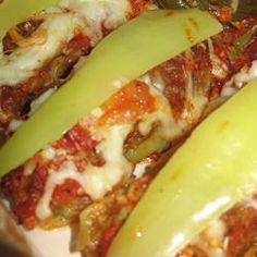 This is an awesome recipe for banana peppers stuffed with an Italian sausage mixture and baked in a delicious tomato sauce. We get requests to make them for the guys my husband works with all the time. Recipes With Banana Peppers, Sweet Banana Peppers, Hot Pepper Recipes, Stuffed Banana Peppers, Banana Recipes, Sausage Stuffed Peppers, Hungarian Stuffed Peppers, Good Food, Yummy Food